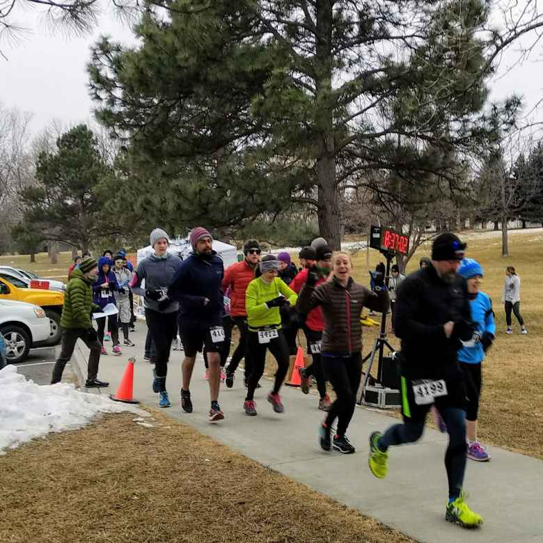 Runners starting their wave at the 2018 Edora Park 8-kilometer Tortoise & Hare race by the Fort Collins Running Club.