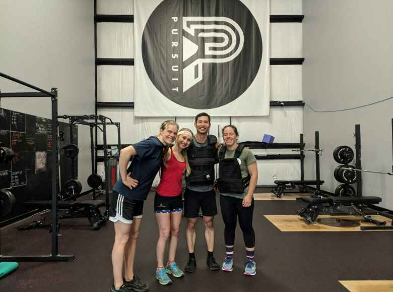 Evelyn, Emily, Felix, and Jennifer at Pursuit Nutrition & Fitness for the Murph Challenge.