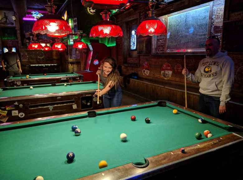 Morgan shooting pool for only her third time at the Trail Head Tavern.