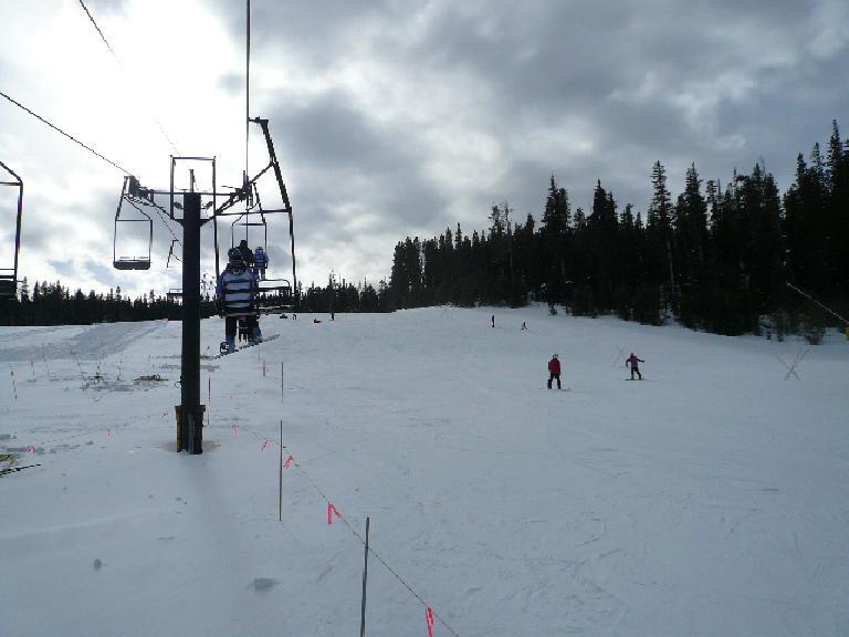 Skiers coming down the Ho Hum ski run.