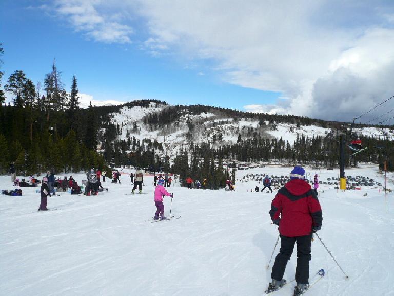 Skiers at the bottom of the Ho Hum ski run.