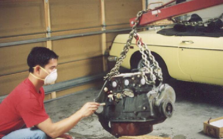 Felix Wong prepping the just-rebuilt engine with acid for painting.