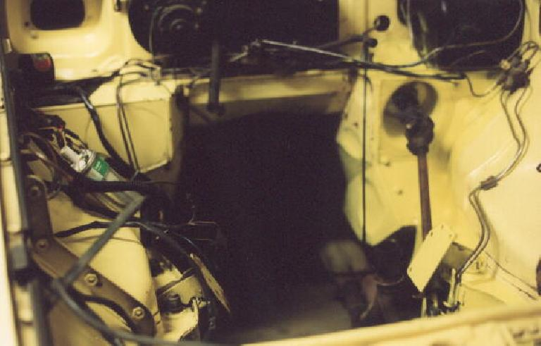 I also cleaned and partly painted the engine compartment while the engine was out. (May 4, 2002)
