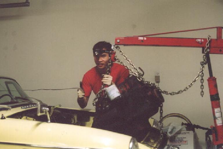 Success!  Felix Wong removing the engine and transmission with the engine hoist. (February 18, 2002)
