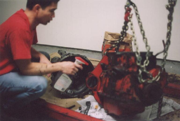Here's a picture taken after I unbolted the tranny from the engine and did hours worth of cleaning.  Note that the engine is now red and the transmission silver! (February 18, 2002)