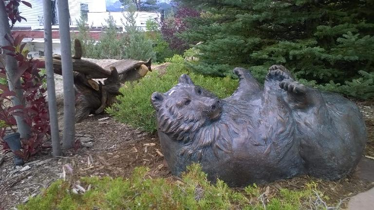 An upside down bear statue outside the Stanley Hotel.
