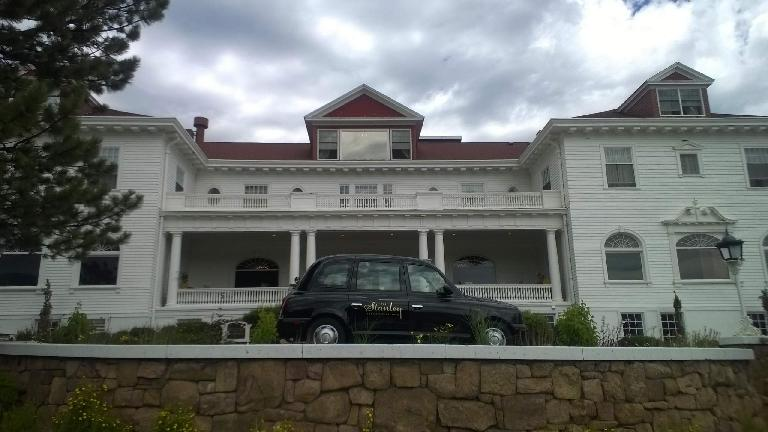 London Taxi (black TX4 Hackney Carriage) in front of the Stanley Hotel.