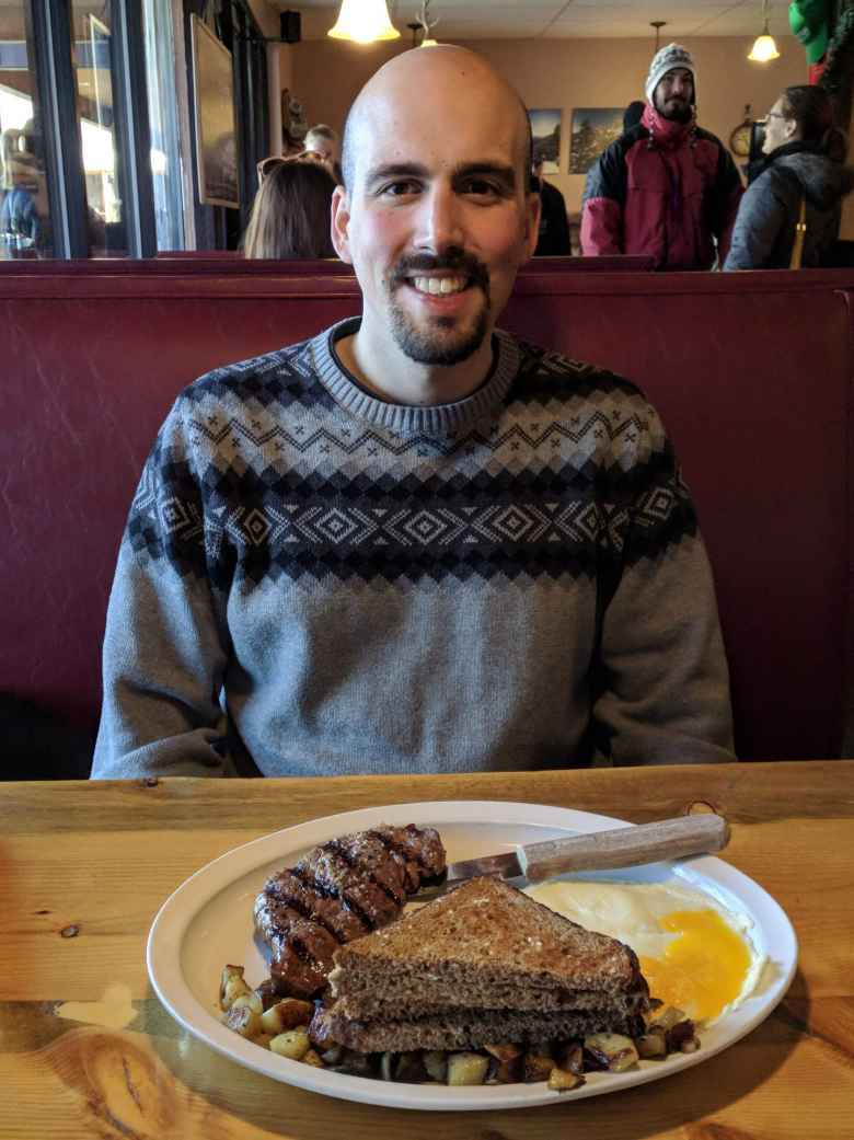 Manuel with a steak breakfast entree at the Notchtop Bakery & Diner in Estes Park.