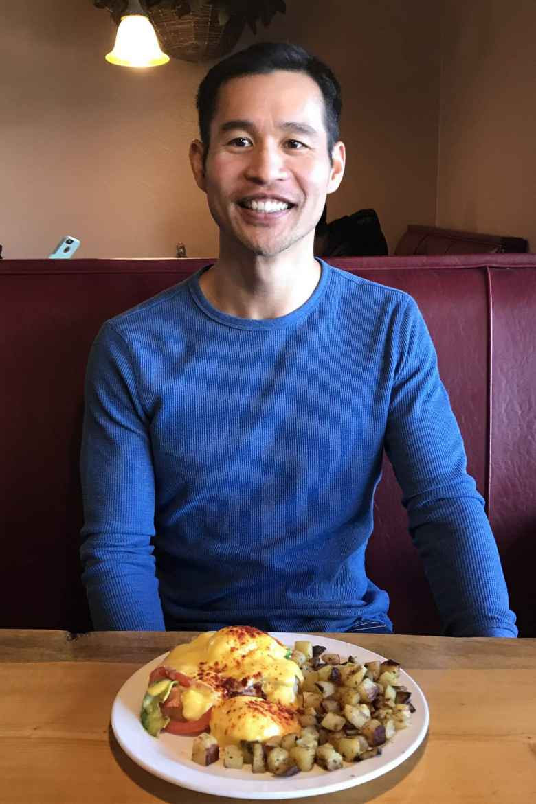 Felix with Eggs Benedict at the Notchtop Bakery & Diner in Estes Park.