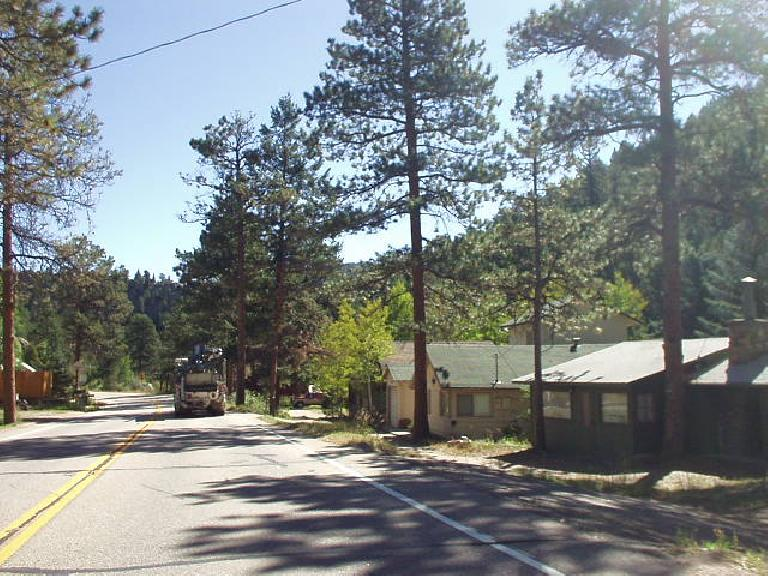 Homes among the pine along US Route 34 to Loveland, which is about 30 miles from Estes.