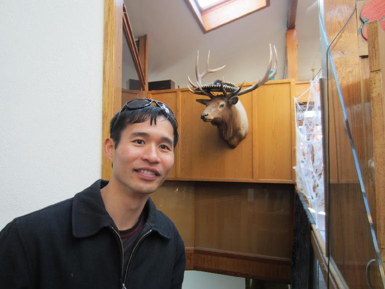 Felix Wong and an elk head.