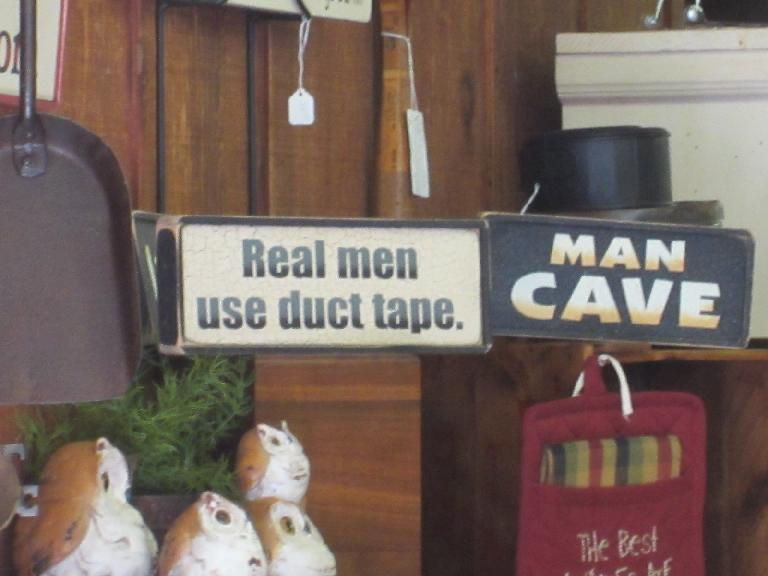 """Real men use duct tape"" sign"