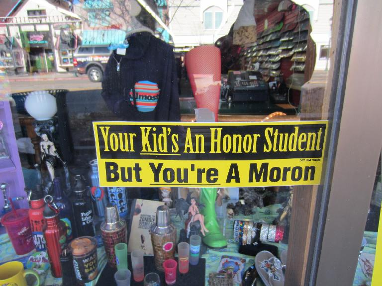 """Your kidś an honor student but youŕe a moron"" bumper sticker."