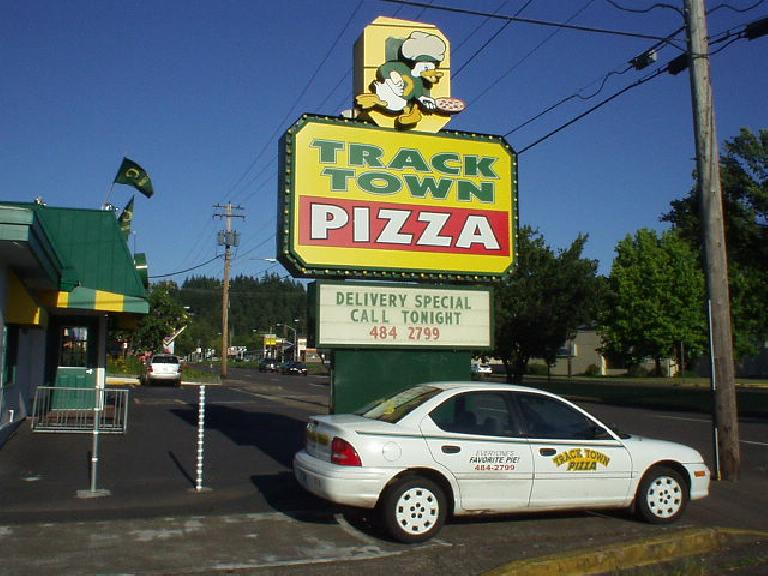 Here's Track Town Pizza near the university.  Unfortunately it didn't look like it serve by the slice so I didn't try out the pizza...