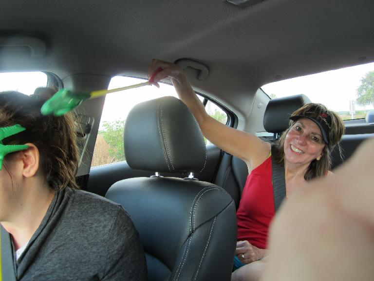 Kelly and her mom going at it with their alligator toys while I drove. (February 9, 2013)