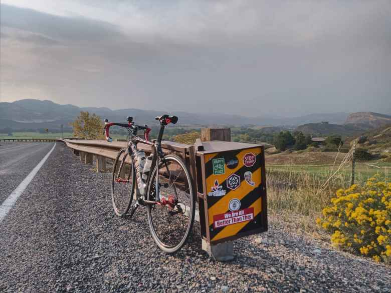 My black 2020 Litespeed Archon C2 at the top of Bingham Hill in Laporte, Colorado, next to a stickered sign.