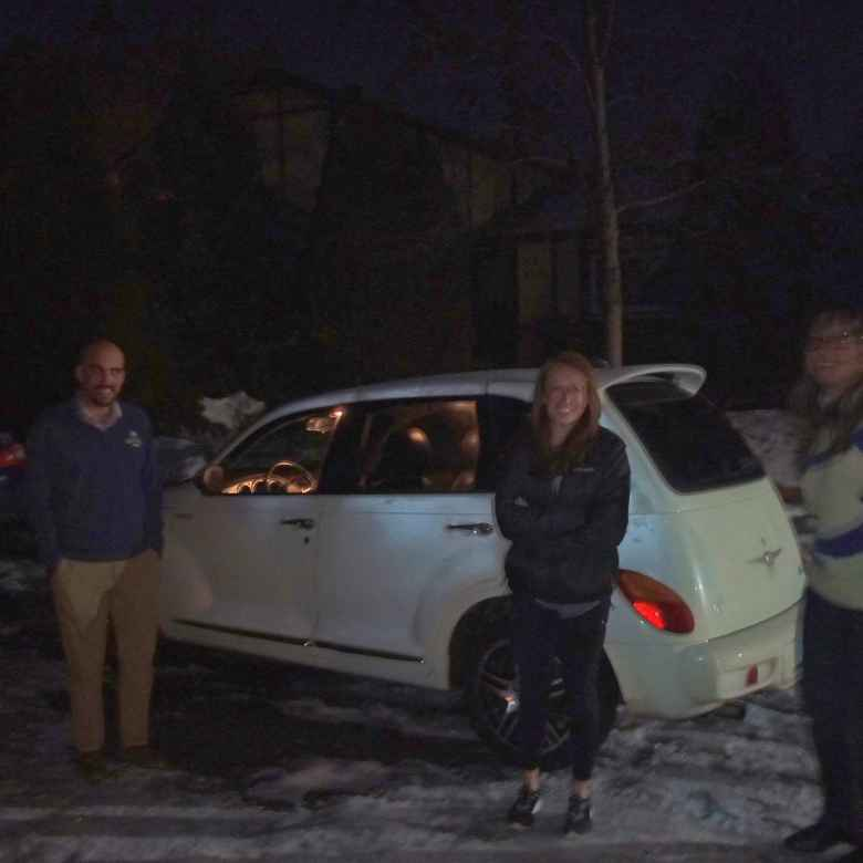 Manuel, Brooke, and Angela saying goodbye to Peter the PT Cruiser GT.