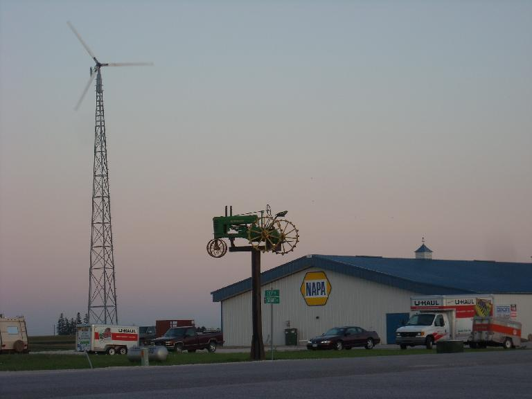 A windmill and lawn tractor by a Napa Auto Parks store not too far from Des Moines, Iowa. (August 11, 2011)