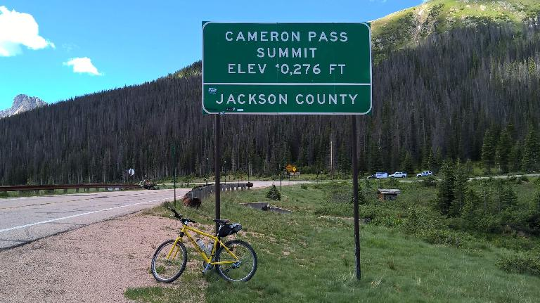 My yellow 1996 Cannondale F700 mountain bike at the summit of Cameron Pass.