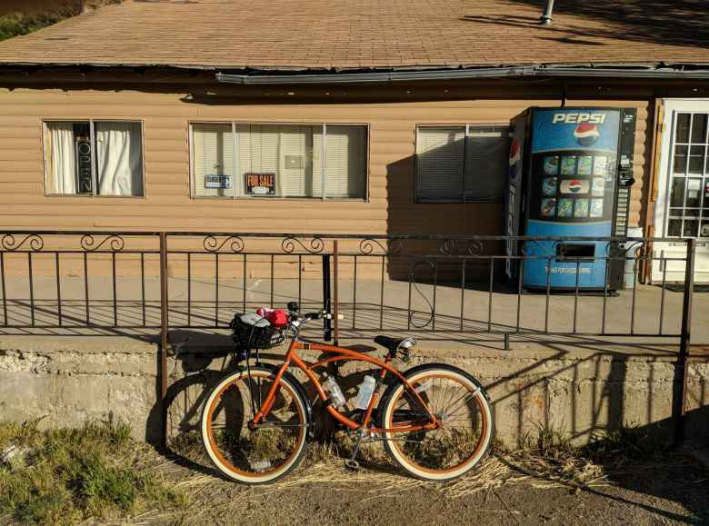 bronze Huffy Cranbrook Cruiser in front of store with vending machine
