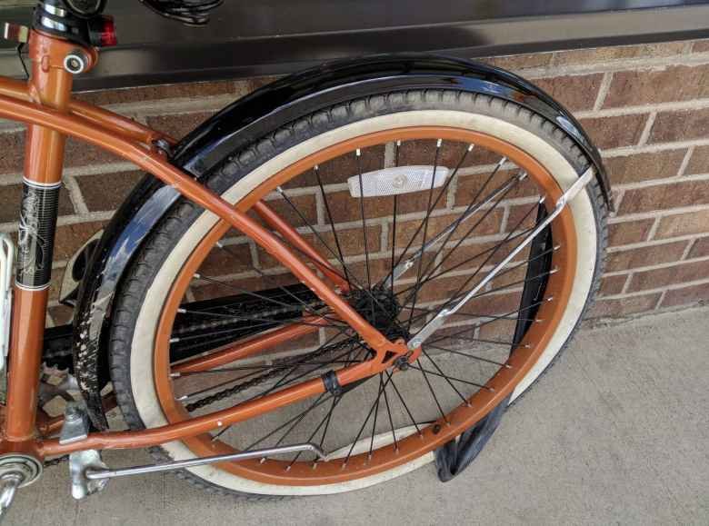 bronze Huffy Cranbrook Cruiser, tube outside of flat rear tire
