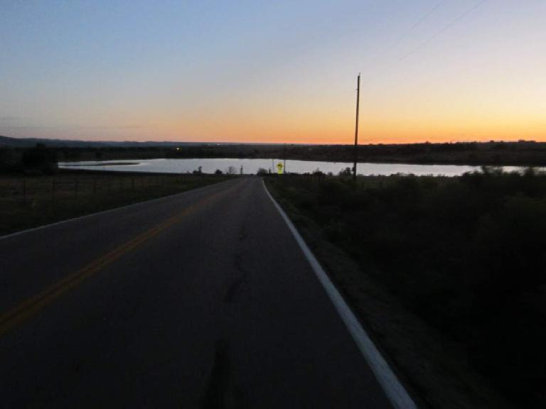 [Mile 3] Sunrise beyond the Kluver Reservoir.