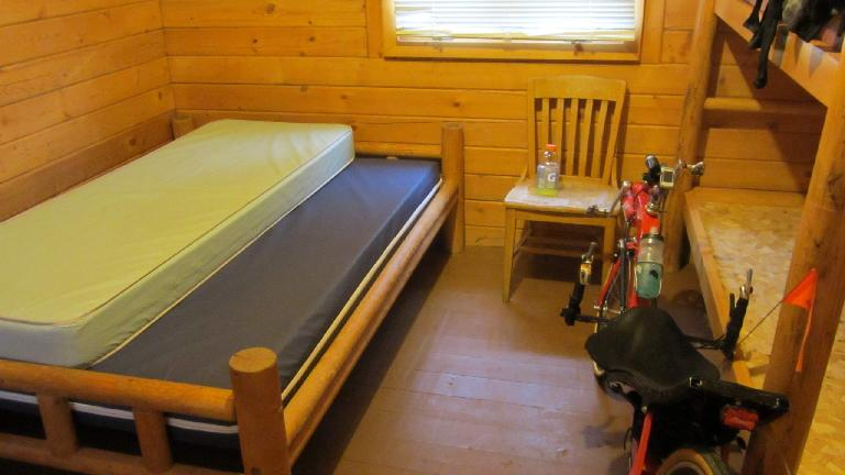 The KOA cabin I made an emergency stay at did not have blankets, so I took the mattresses from the bunks and slept under both of them for the night. (Only one shown in photo.)