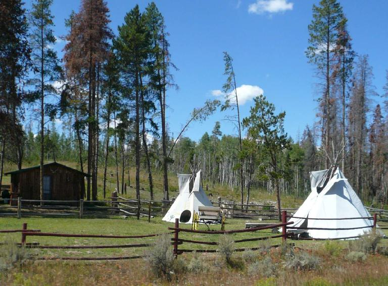 [Mile 86, 12:23p] Teepees around Gould, CO.