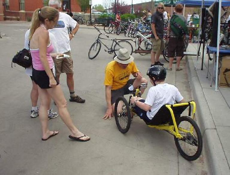 Rob of the Fort Collins Recumbents bicycle shop assists a guy trying out a race trike.