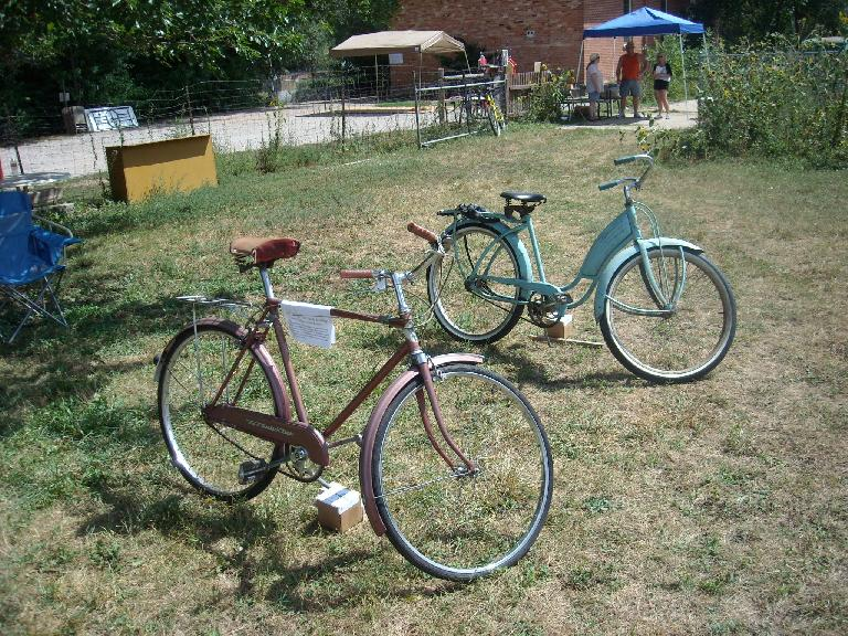 A 1957 Western Flyer Sports Roadster (by Norman Cycles of England) that was purchased new from Western Auto in Lander, Wyoming by its current owner in 1958. There was no info on the turquoise step-through bike.