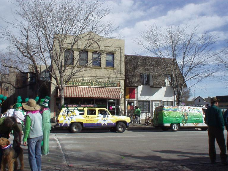 Floats lining up in front of the Fort Collins Food Co-op wait for their turn to enter the parade.