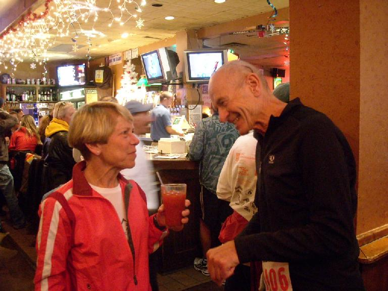 Cathy, forever young, won a pie for winning her age group. Here she is talking with a friend.