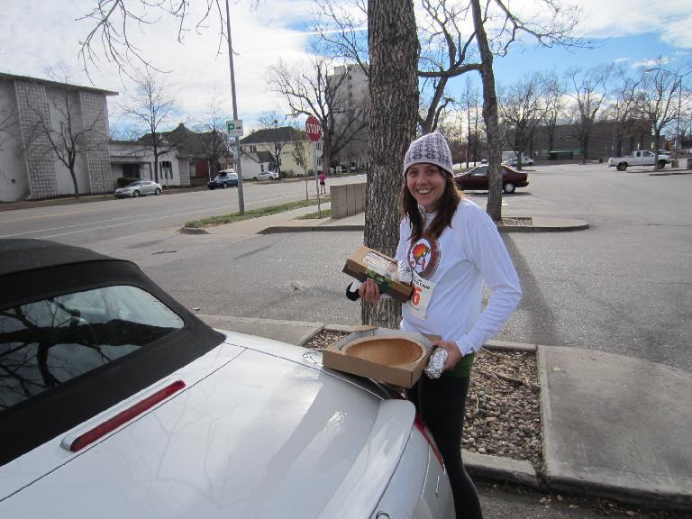 Kelly with some of the stuff we brought home from the race: a pumpkin and apple pie.