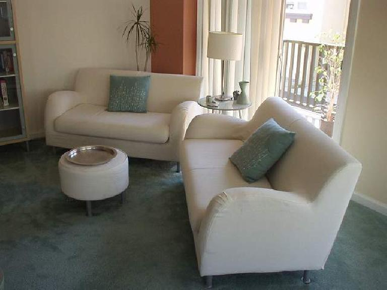 Felix Wong townhouse, living room, Fremont, two white Ikea love seats, white Ikea ottoman, silver platter