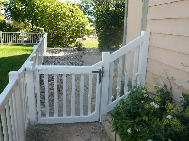 "An ""after"" shot of the front of the side gate and fence."