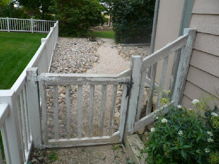 "An ""before"" shot of the front of the side gate and fence."