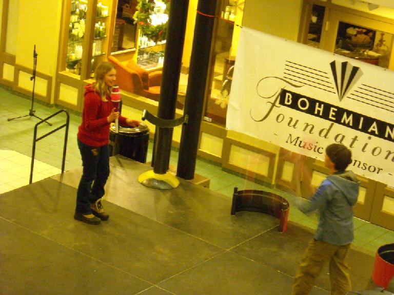 "Sven Jorgensen and a volunteer juggling at ""SOAR -- amazing balance act."""