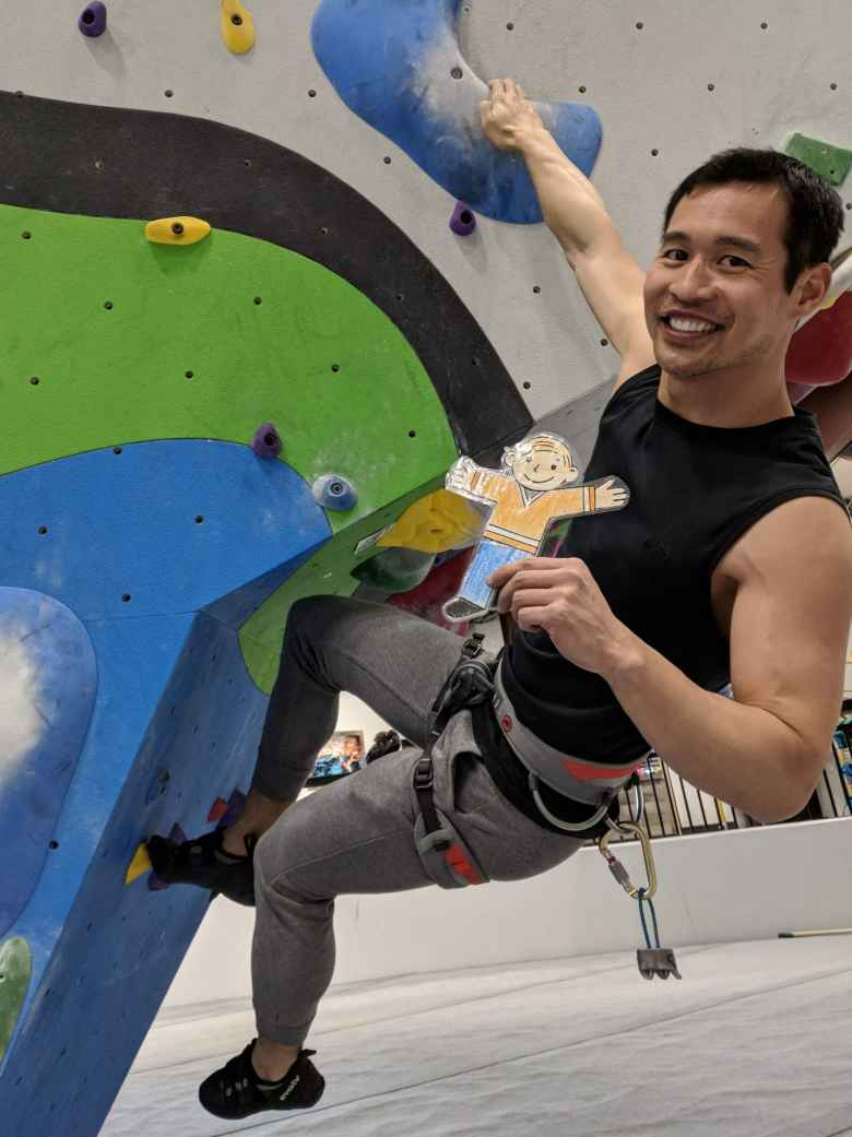 Felix bouldering with Flat Stanley inside the new Whetstone climbing gym.
