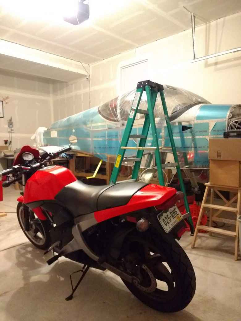 I once had to stop by my friend's place to make an emergency repair in south Fort Collins. My Buell looked pretty good next to the wingless plane.