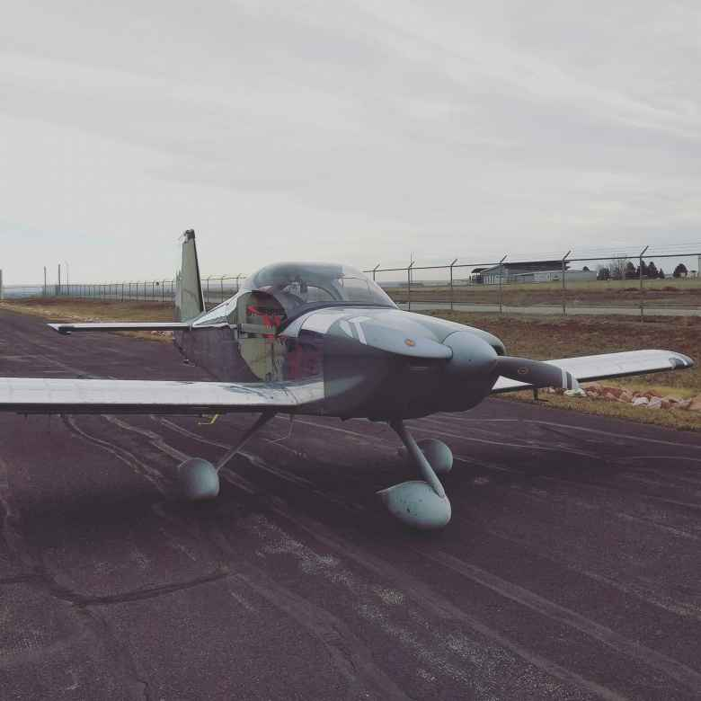 The Van's RV-14A homebuilt aircraft after rolling it out of my friend's hangar.