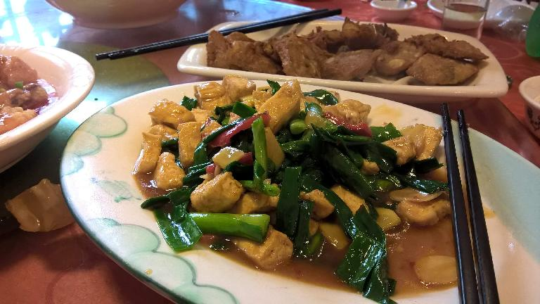 Tofu, green onions and red peoples.