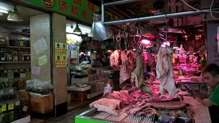 Raw pig hung up at a market in Guangzhou, China. (April 21, 2016)
