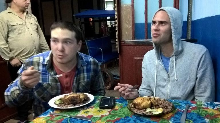 Matt and Alex eating ropa vieja de pollo at a Criole restaurant on Calle Virtudes (near Calle Industria).