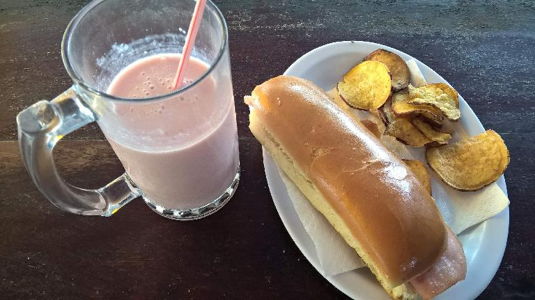 Batido de guayaba (guava milkshake), bocadito de jamón y queso (ham and cheese sandwich), and fried plantains at the Guajiro restaurant in Guanabo, Cuba.