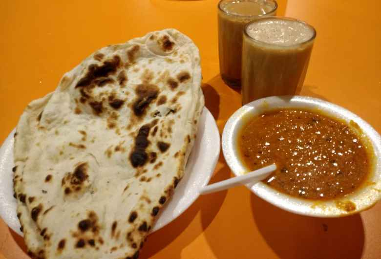 Late night Naan, daal, and chai (I think) in Little India.