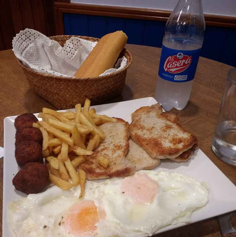 Menú del día with eggs, meat balls, pork chops, french fries, and bread.  I also had a limonada gaseosa (kind of like a Sprite).