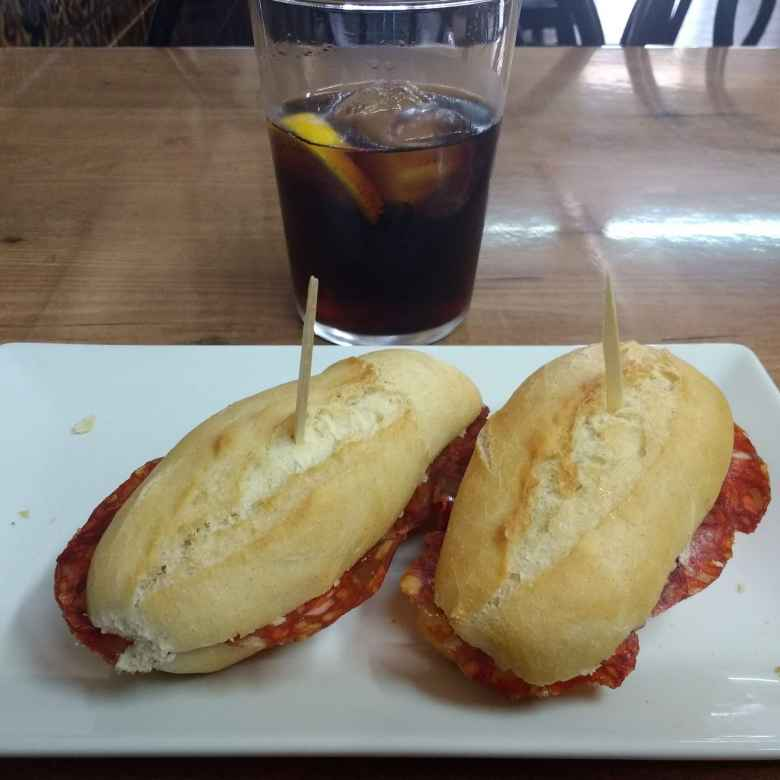 Two bocadillos de salami and a cup of Coke.