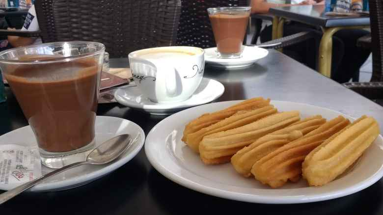 Churros with chocolate in Santiago de Compostela, Spain.