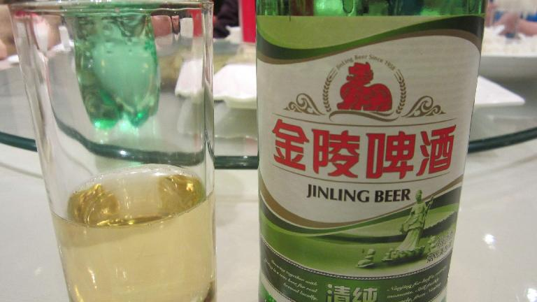 Jinling Beer. Beer in China was typically very low in alcohol (2.5%). (May 20, 2014)