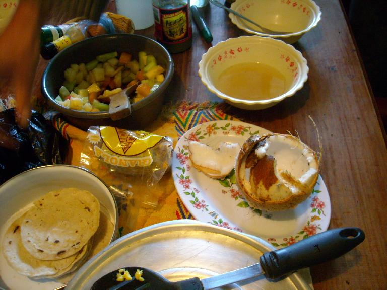 A typical breakfast we'd make at Maya Pedal included a fruit salad and tortillas.  Eric cut open the coconut with a machete. (December 26, 2010)